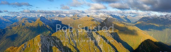 Looking ENE along Edith - George River alpine tops to the head of the George. Edith River and Saddle right. Glaisnock Wilderness Area. Panorama, Fiordland National Park, Southland District, Southland Region, New Zealand (NZ) stock photo.