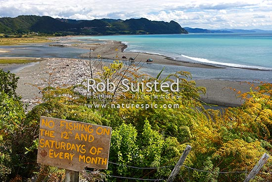 Fishing sign at the Motu River Mouth declaring an indigenous Maori rahui or closure, Motu, Opotiki District, Bay of Plenty Region, New Zealand (NZ) stock photo.