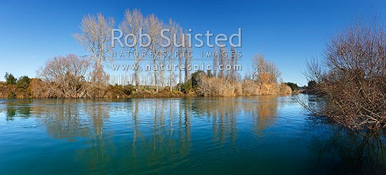 Waikato River passing through willow tree lined banks and farmland, in mid winter. Summer winter comparision shots available (35994fr00, 39602fr00 etc), Mihi, Rotorua, Rotorua District, Bay of Plenty Region, New Zealand (NZ) stock photo.
