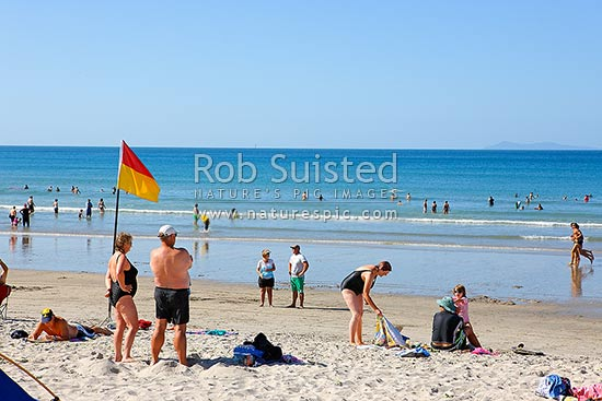 Mt Maunganui Beach. People enjoying summertime holidays on the beach, Mount Manganui, Tauranga District, Bay of Plenty Region, New Zealand (NZ) stock photo.
