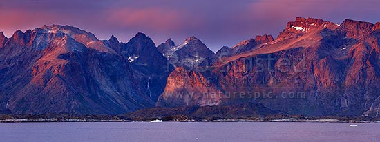 Greenlandic sunset on fiords, mountains and icebergs near Narsarmijit in Kujalleq municipality, Prince Christian Sound, panorama, Prins Christian Sund, South Greenland, Greenland stock photo.