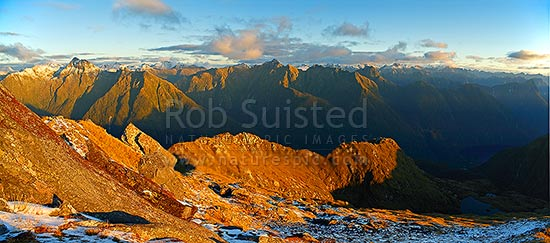 Looking across the Edith River to the Edith-Wapiti River alpine tops at dusk. Lake Alice right. Glaisnock Wilderness Area panorama, Fiordland National Park, Southland District, Southland Region, New Zealand (NZ) stock photo.