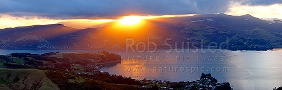 Otago Harbour sunset over Broad Bay, Mount Cargill beyond. Winter panorama, Otago Peninsula, Dunedin City District, Otago Region, New Zealand (NZ) stock photo.