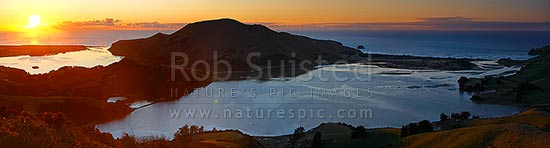 Otago Peninsula farmland and beaches around Hoopers Inlet. Allans Beach centre, Papanui Inlet left, and Sandy Mount right. Sunrise panorama, Otago Peninsula, Dunedin City District, Otago Region, New Zealand (NZ) stock photo.