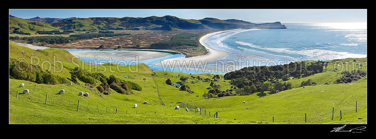 Image of Looking across farmland to Okia Flat, Victory Beach and Wickliffe Bay to Te Whakarekaiwi Point. Papanui Inlet centre left. Panorama, Otago Peninsula, Dunedin City District, Otago Region, New Zealand (NZ) stock photo image
