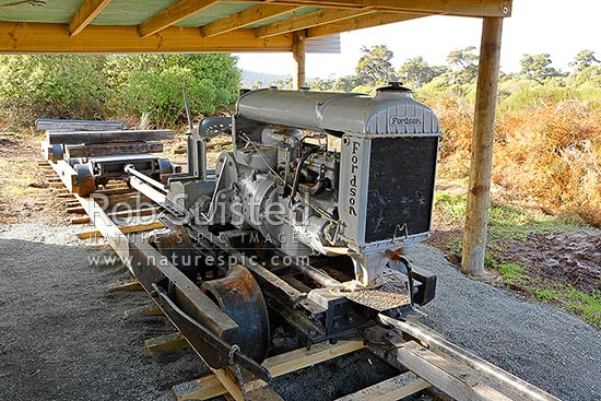 Historic Trails Tractor bush tramway locomotive engine and powered bogies. Fordson farm tractor converted for use on wooden rails by Frank Traill 1924, on display at Tautuku, Catlins, Clutha District, Otago Region, New Zealand (NZ) stock photo.