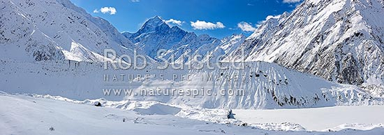 Aoraki / Mount Cook (3754m centre left) in winter snow. Looking over the Mueller Glacier and lake up the Hooker River Valley. Mt Cook Range right. Panorama, Aoraki / Mount Cook National Park, MacKenzie District, Canterbury Region, New Zealand (NZ) stock photo.