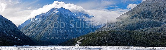 Bealey River Valley with Mount O'Malley (1703m) cloaked in heavy winter snowfall. Mingha River valley centre, Arthur's Pass National Park, Selwyn District, Canterbury Region, New Zealand (NZ) stock photo.