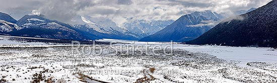 Waimakariri River valley from Cora Lynn. Looking up to the Southern Alps in heavy winter snow. Panorama, Arthur's Pass National Park, Selwyn District, Canterbury Region, New Zealand (NZ) stock photo.