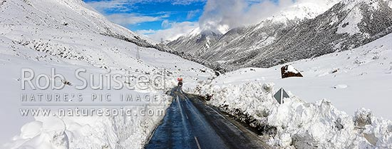 Arthur's Pass road in heavy winter snow. State Highway 73 to West Coast. Looking east with road clearing machinery working. Panorama, Arthur's Pass National Park, Selwyn District, Canterbury Region, New Zealand (NZ) stock photo.