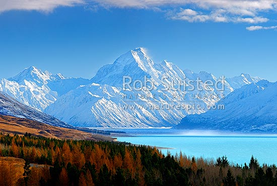 Aoraki / Mount Cook (3754m) and Lake Pukaki in winter. Mt La Perouse (3078m) left, Tasman Valley and Burnett Mountains Range right. Late autumn colours, Aoraki / Mount Cook National Park, MacKenzie District, Canterbury Region, New Zealand (NZ) stock photo.