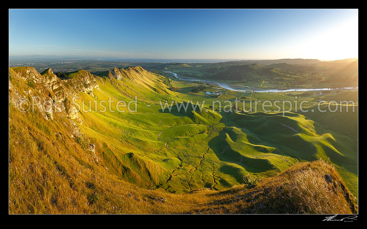 Image of Sunrise on Te Mata Peak (399m). Overlooking Hawke Bay and the Tukituki River with Napier far left. Panorama, Hawke's Bay, Hastings District, Hawke's Bay Region, New Zealand (NZ) stock photo image