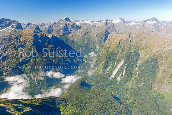 Milford Track Great Walk aerial photo. Mackinnon Pass centre left, and Arthur River valley below, Milford Sound, Fiordland National Park, Southland District, Southland Region, New Zealand (NZ) stock photo.