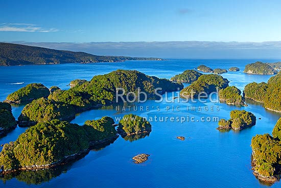 Dusky Sound entrance and islands around Anchor Island. South Point distant. World Heritage Area, Fiordland National Park, Southland District, Southland Region, New Zealand (NZ) stock photo.