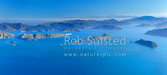 Outer Marlborough Sounds in Queen Charlotte Sound (Totaranui). Arapaoa (Arapawa) Island and East Bay left, Long Island and Kokomohua Islands centre. Motuara Island right. Kaikoura Ranges distant right, Marlborough Sounds, Marlborough District, Marlborough Region, New Zealand (NZ) stock photo.