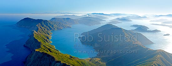 Arapawa Island and Marlborough Sounds aerial panorama. Onauku Bay in East Bay off Queen Charlotte Sounds. Kaikoura Ranges and Cloudy Bay distant, Cook Strait, Marlborough District, Marlborough Region, New Zealand (NZ) stock photo.