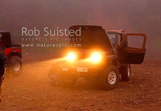 Jeep Wrangler TJ, with headlights on in the mist after a offroad 4WD 4x4 trip outing, New Zealand (NZ) stock photo.