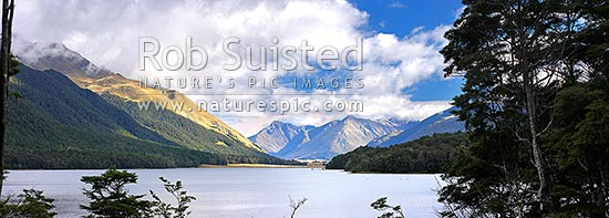 South Mavora Lake nestled between the Livingstone and Thomson Mountains ranges. Snowdon Forest Conservation Area & Mararoa River Valley panorama, Mavora Lakes, Te Anau, Southland District, Southland Region, New Zealand (NZ) stock photo.