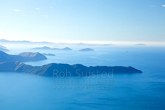 Cape Lambertand Waitui Bay with Alligator Head, Titi Island, Chetwode Islands, D'Urville Island and Stephens Island beyond, Marlborough Sounds, Marlborough District, Marlborough Region, New Zealand (NZ) stock photo.