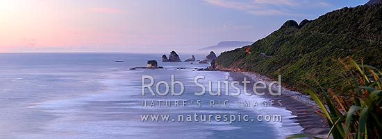 Rugged West Coast coastline near Motukiekie Rocks (Ten Mile Creek / Waianiwaniwa) at sunset. Paparoa Ranges beyond, Rapahoe, Grey District, West Coast Region, New Zealand (NZ) stock photo.