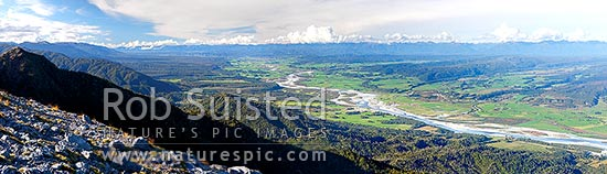 Grey River valley panorama with towns of Blackball, Ahaura, Nelson Creek, Ngahere, below the Paparoa Range (left). Victoria Range distant right, Grey Valley, Grey District, West Coast Region, New Zealand (NZ) stock photo.