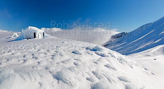 Symes Hut on Fantham's Peak (Panitahi) at 1962 m, on the side of Mt Taranaki, encrusted with winter ice. Panorama, Egmont National Park, Taranaki, Stratford District, Taranaki Region, New Zealand (NZ) stock photo.