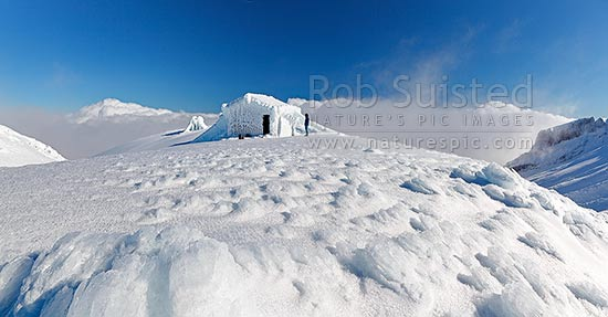 Syme Hut on Fantham's Peak (Panitahi) at 1962 m, on the side of Mt Taranaki, encrusted with winter ice. Panorama, Egmont National Park, Taranaki, Stratford District, Taranaki Region, New Zealand (NZ) stock photo.