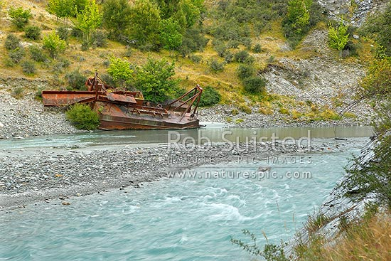 Gold mining dredge ruins rusting at Maori Point, on the Shotover River, Skippers Road, Queenstown, Queenstown Lakes District, Otago Region, New Zealand (NZ) stock photo.