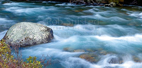 Buller River passing through rapids and rocks near Lake Rotoiti and its headwaters. Panorama, Nelson Lakes National Park, Tasman District, Tasman Region, New Zealand (NZ) stock photo.