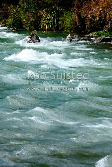 River rapids blurred with fast flowing water movements. Buller River head waters, Nelson Lakes National Park, Tasman District, Tasman Region, New Zealand (NZ) stock photo.
