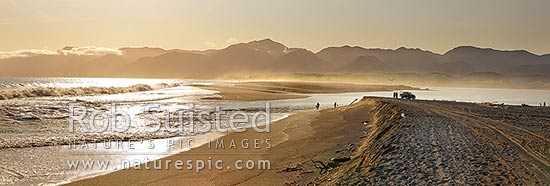 Lake Onoke entrance and Ruamahanga River mouth in Palliser Bay with fishermen and whitebaiters in evening. Rimutaka Ranges beyond. Panorama, Lake Ferry, South Wairarapa District, Wellington Region, New Zealand (NZ) stock photo.