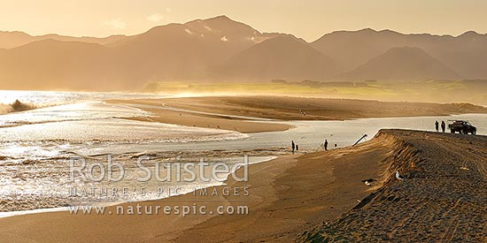Lake Onoke entrance and Ruamahanga River mouth in Palliser Bay with whitebaiters in evening. Rimutaka Ranges and Mt Matthews beyond, Lake Ferry, South Wairarapa District, Wellington Region, New Zealand (NZ) stock photo.