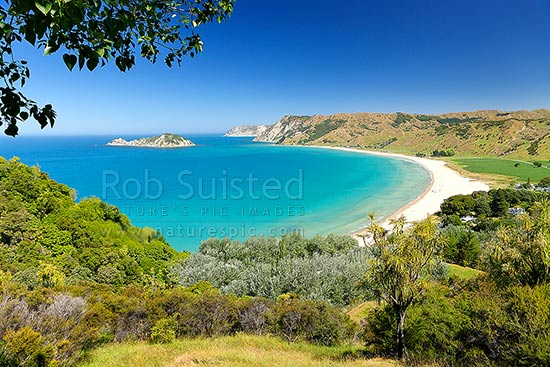Anaura Bay with Motuoroi Island left and Marau Point in distance. Site of Captain James Cook landing in 1769, Anaura Bay, East Coast, Gisborne District, Gisborne Region, New Zealand (NZ) stock photo.