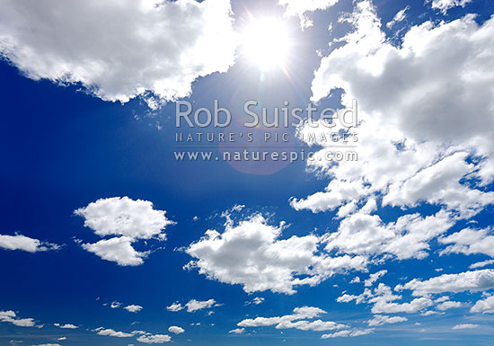 Blue sky, sun and clouds, New Zealand (NZ) stock photo.