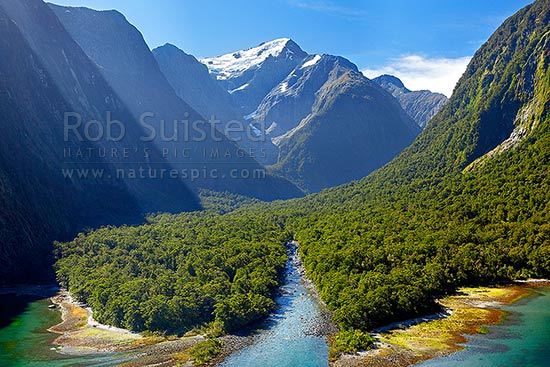 Harrison River Valley in Milford Sound. Looking up to Mount Pembroke (2015m), Pembroke Glacier and Creek, Fiordland National Park, Southland District, Southland Region, New Zealand (NZ) stock photo.