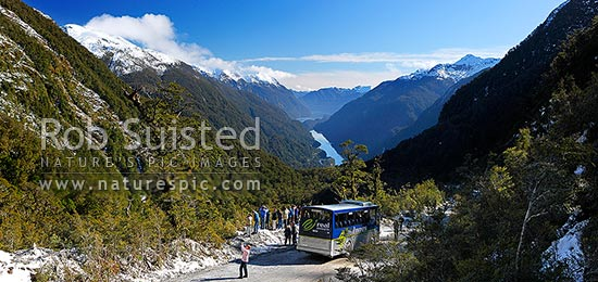 Real Journeys coach on the Wilmot Pass Road for tourists to photograph Deep Cove and Doubtful Sound on a beautiful winter day, Doubtful Sound, Fiordland National Park, Southland District, Southland Region, New Zealand (NZ) stock photo.