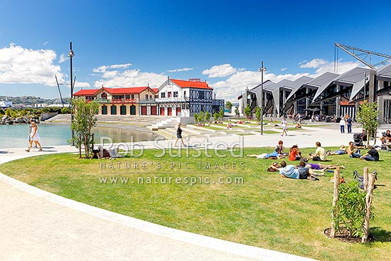 Wellington waterfront city lagoon with historic Rowing and Boating club, Wharewaka, Odlins and St Johns Ambulance buildings, and people enjoying summer, Wellington, Wellington City District, Wellington Region, New Zealand (NZ) stock photo.