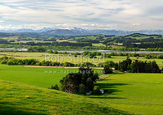 Hurunui River and farmland near Domett, with the Amuri Ranges behind with spring snow, Hurunui Mouth, Hurunui District, Canterbury Region, New Zealand (NZ) stock photo.