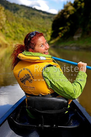 Happy day canoeing the Whanganui River on summer day. Tourist traveller canoeist enjoying a popular trip through the National Park, Whanganui National Park, Wanganui District, Manawatu-Wanganui Region, New Zealand (NZ) stock photo.