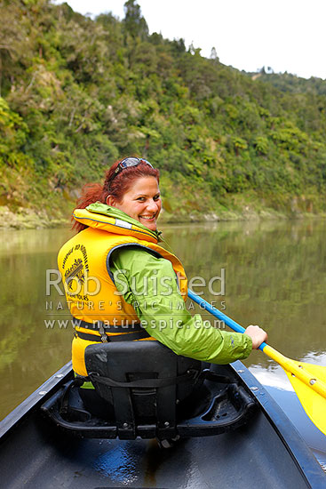 Canoeing the Whanganui River. Tourist traveller canoeist enjoying a popular trip through the National Park, Whanganui National Park, Wanganui District, Manawatu-Wanganui Region, New Zealand (NZ) stock photo.