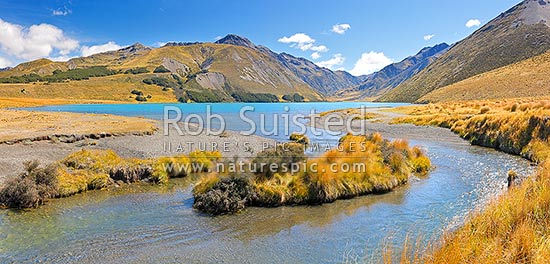 Lake Tennyson draining into the Clarence River. Lake Tennyson Scenic Reserve. Saint James Range and Mount McCabe (1606m) centre left. Panorama, St James Station, Hurunui District, Canterbury Region, New Zealand (NZ) stock photo.