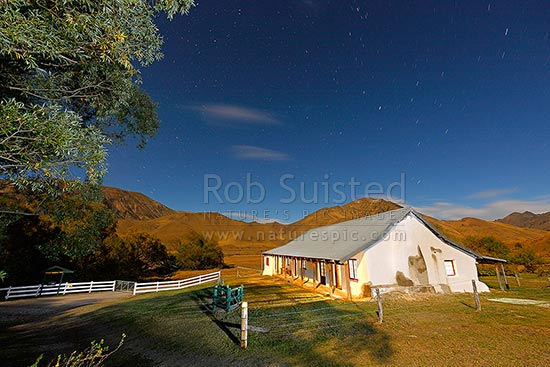 Acheron Accommodation house, an historic cobb construction from 1863, by the Clarence River. Night time shot taken on full moon time exposure, Molesworth Station, Marlborough District, Marlborough Region, New Zealand (NZ) stock photo.