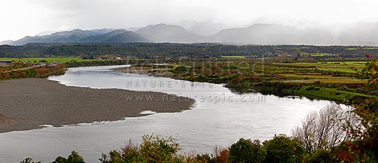 Grey River / Mawheranui near Greymouth, looking north to the Paparoa Ranges. Panorama, Greymouth, Grey District, West Coast Region, New Zealand (NZ) stock photo.