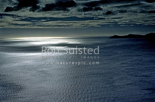 Kapiti Island and seascape. Patterns on the water and in the cloud formations, Pukerua Bay, Porirua City District, Wellington Region, New Zealand (NZ) stock photo.