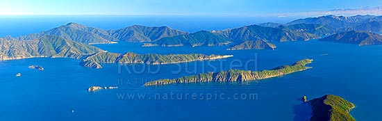 Marlborough Sounds, outer Queen Charlotte Sound, Long Is with Arapawa Island behind. Kaikoura Ranges distant. Aerial panaroma, Marlborough Sounds, Marlborough District, Marlborough Region, New Zealand (NZ) stock photo.