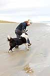 Woman and border collie dog