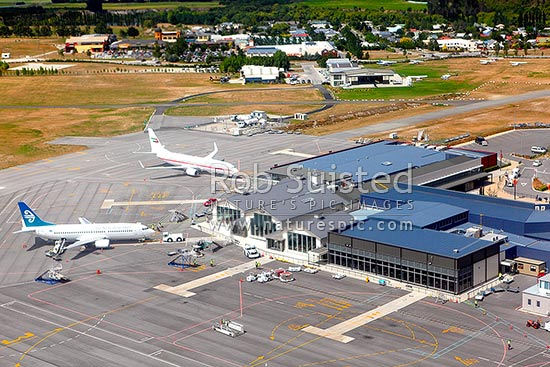 Queenstown Airport terminal and planes from above, Queenstown, Queenstown Lakes District, Otago Region, New Zealand (NZ) stock photo.