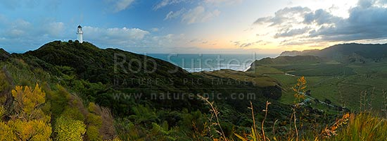 East Cape lighthouse at dusk, Tunanui Stream and Waikori Bluff distant right. Panorama, East Cape, Gisborne District, Gisborne Region, New Zealand (NZ) stock photo.