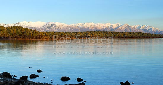 Lake Manapouri panorama looking towards to snowy Takitimu Mountains range in winter, Manapouri, Southland District, Southland Region, New Zealand (NZ) stock photo.