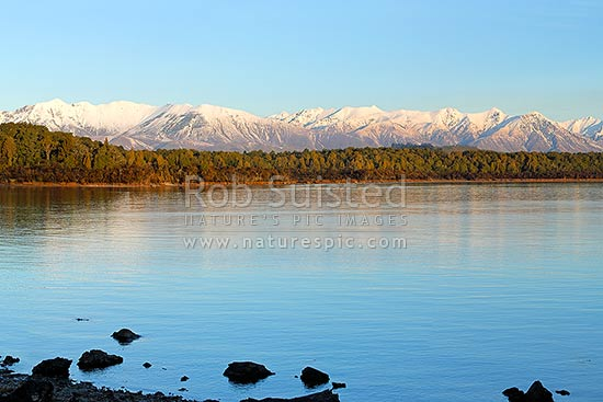 Lake Manapouri looking towards to snowy Takitimu Mountains range in winter, Manapouri, Southland District, Southland Region, New Zealand (NZ) stock photo.